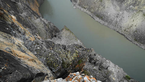 Looking down cliff to river below Footage