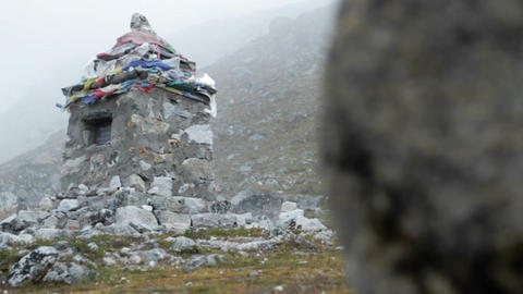 Wider shot of cairn from behind rock Stock Video Footage