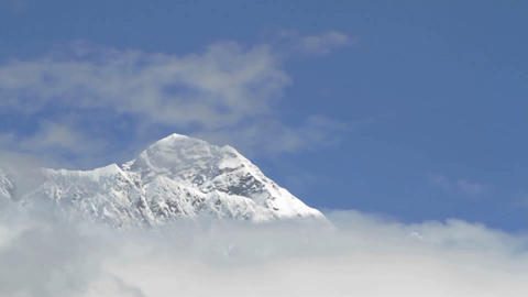 Summit of Everest surrounded by cloud Stock Video Footage