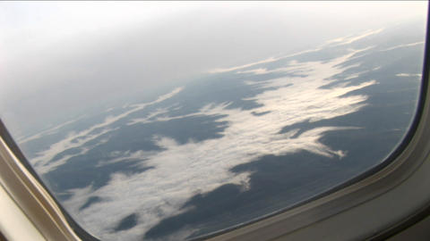 Fly-over clouds fill the valley Stock Video Footage