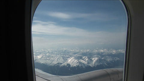 View of mountain outside plane window Stock Video Footage