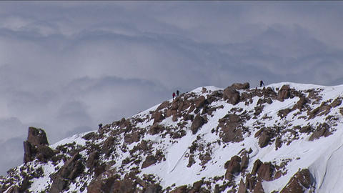 Climbers on the west ridge with clouds in the background Footage
