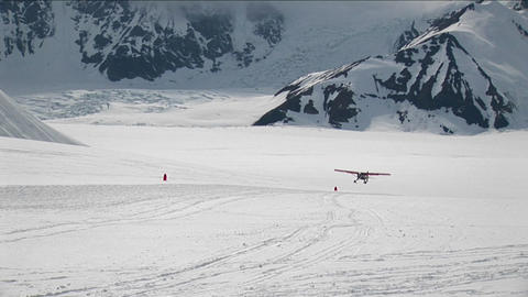 Plane landing on glacier Stock Video Footage