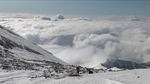 Climbers moving high above the clouds Stock Video Footage