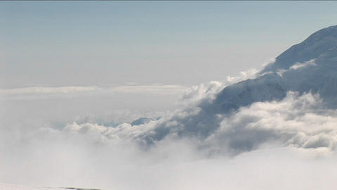 Looking out above the clouds at Mount Foraker Stock Video Footage
