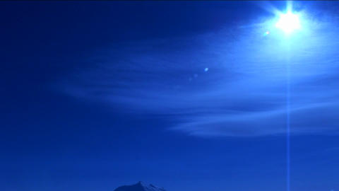 Sun shining about clouds in blue light Stock Video Footage