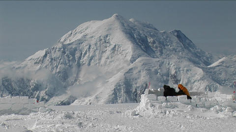 Tent being set up with Mt. Foraker Stock Video Footage