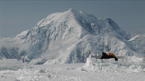 Tent being set up with Mt. Foraker Footage