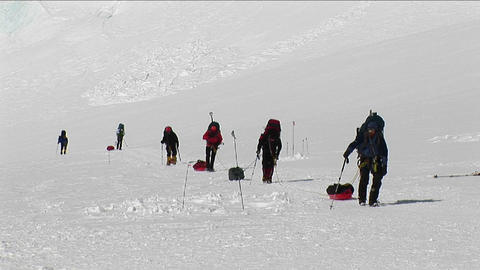 Climbers with sleds approaching camp Stock Video Footage
