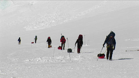 Climbers with sleds approaching camp Live Action