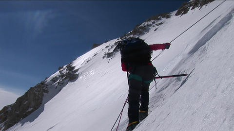 Climber descending down slope Stock Video Footage