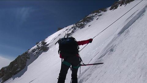 Climber descending down slope Live Action