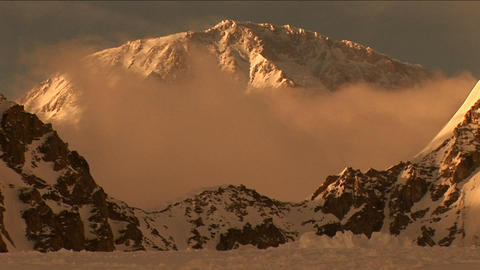 Denali with cloud in front at sunset Stock Video Footage