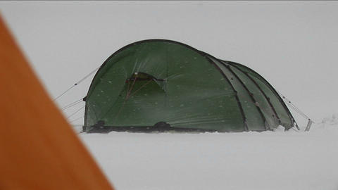 Tent in a blizzard Stock Video Footage