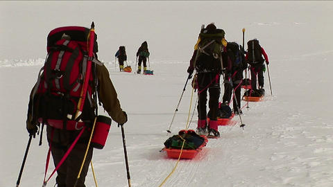 Climbers with snowshoes and sleds headed up Stock Video Footage