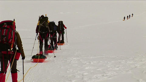 Climbers with snowshoes and sleds headed up Footage