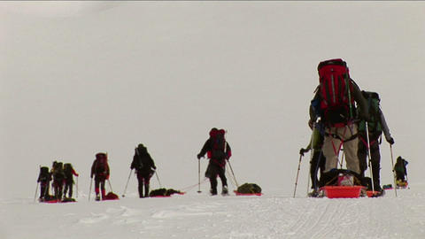 Climbers with snowshoes and sleds Stock Video Footage