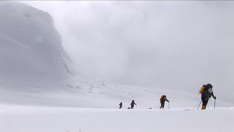 Climbers ascending with snow coming down Stock Video Footage