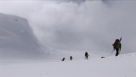 Climbers ascending in deep snow Stock Video Footage