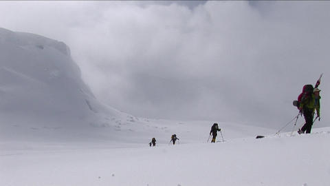 Climbers ascending in deep snow Footage