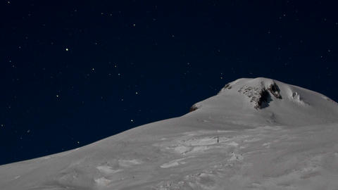 Close-up of summit with the stars behind it Stock Video Footage