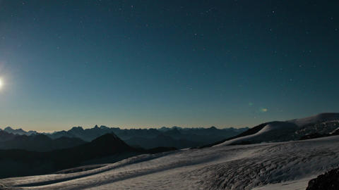 Sun setting over Caucasus range. Footage