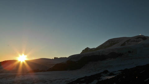 Sunset on flank of mountain Stock Video Footage