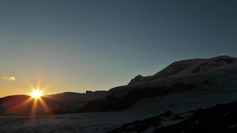 Sunset on flank of mountain Stock Video Footage