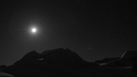 Moon setting behind mountain. Stock Video Footage