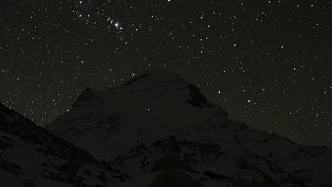 Climbers high on the mountain at night Stock Video Footage