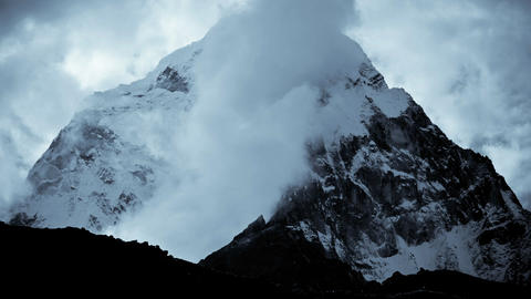 Dark peak with clouds moving around it Stock Video Footage