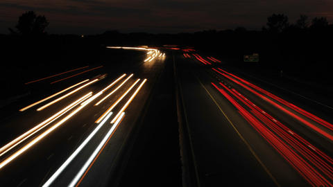 Cars passing by from overpass at sunset Stock Video Footage
