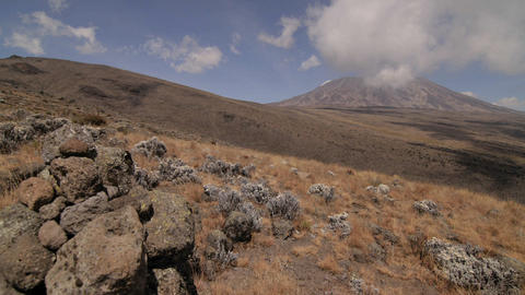 Kilimanjaro, clouds above, rocks in front Footage