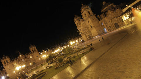 Plaza de armas at night in Cusco, cars passing by Stock Video Footage
