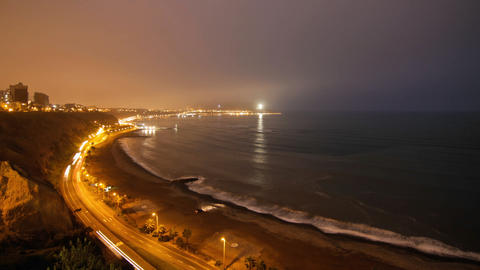 Lima coastline light up at night by cars Stock Video Footage