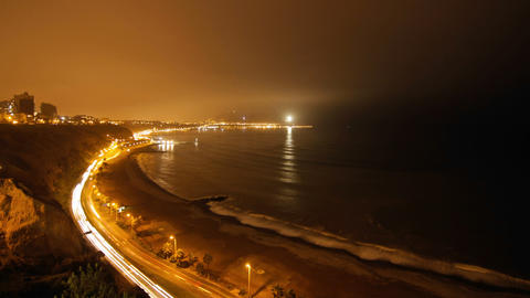 Lima coastline light up at night by cars Footage