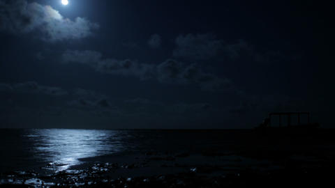 Moon over the water from the beach Footage