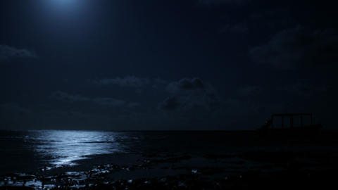Moon over the water from the beach Stock Video Footage