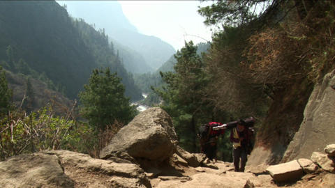 Porters coming up the trail Stock Video Footage