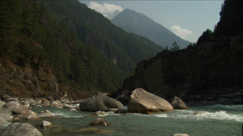 Mountain stream with high peak in background Stock Video Footage