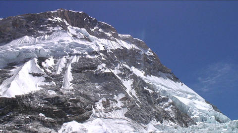 Tilt down from peak to Khumbu icefall Stock Video Footage
