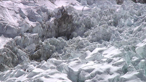 Climbers in icefall looking small Footage