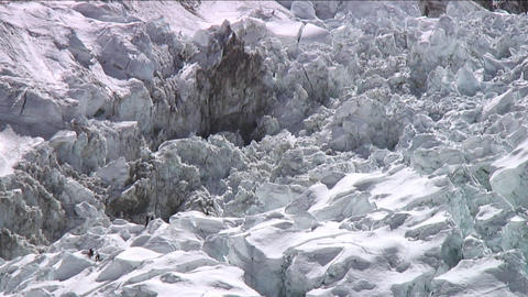 Climbers in icefall looking small Stock Video Footage