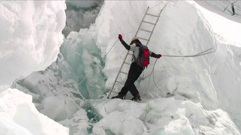 Pan from crevasse to Sherpa holding ropes Stock Video Footage