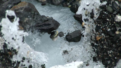 Focus from rocks to glacial stream Stock Video Footage