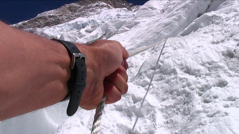 POV using the rope to pull himself up Stock Video Footage