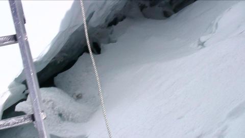POV crossing ladder over deep crevasse Stock Video Footage