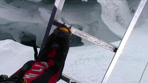 POV crossing ladder over deep crevasse Footage