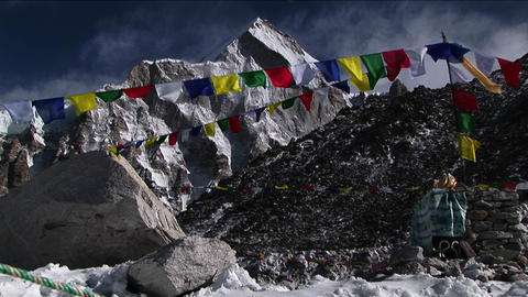 Puja alter with prayer flags and mountain behind Footage