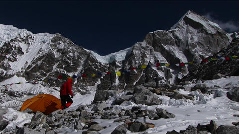 Climber enters tent at basecamp Footage
